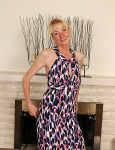 Elegant and  Blond 57 Year Old Pam Strutting Around the Room  Nude