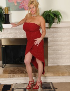 Big-chested and Elegant 47 Year Old Tahnee Taylor Pising by the Fireplace
