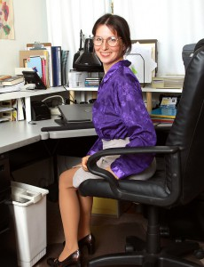 See This Sexy  Older Office Chick As She Stretches for the Camera