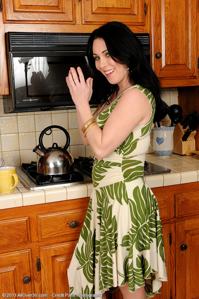 Beautiful  Brown Haired Rayveness Slides Her Finger into Her  Hoo Ha on the Counter