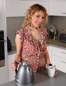 34 Year Old Gina Monelli Shows off Her Love Tunnel While Having a Coffee